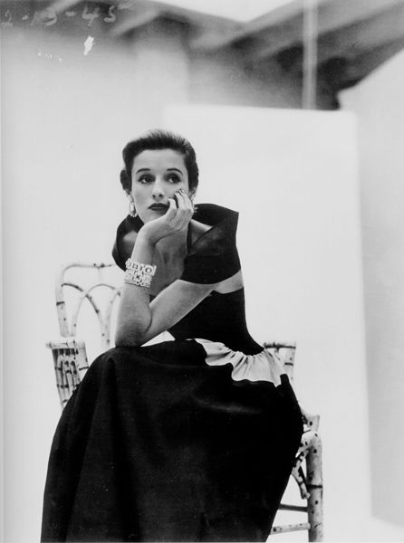 This is Babe Paley. on Page 43 and 44 it talks about Babe Paley in the 1950's and 1960's as a well known high society woman in the U.S.  She is known for starting the trend of tying your scarf to your handbag.