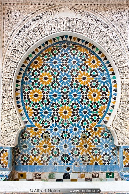 Some cultures use symmetric designs to decorate their buildings. The Islamic culture uses complex symmetries both in their exterior designs and interior layouts. Is this tradition embedded in any other cultures? It is interesting to see how a certain style or method conveys meaning of culture and tradition.