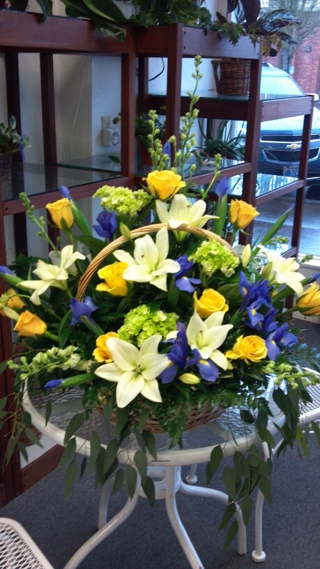 Basket Arrangement With Green Hydrangeas Yellow Roses