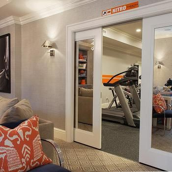 Basement Exercise Room with Mirrored Pocket Doors