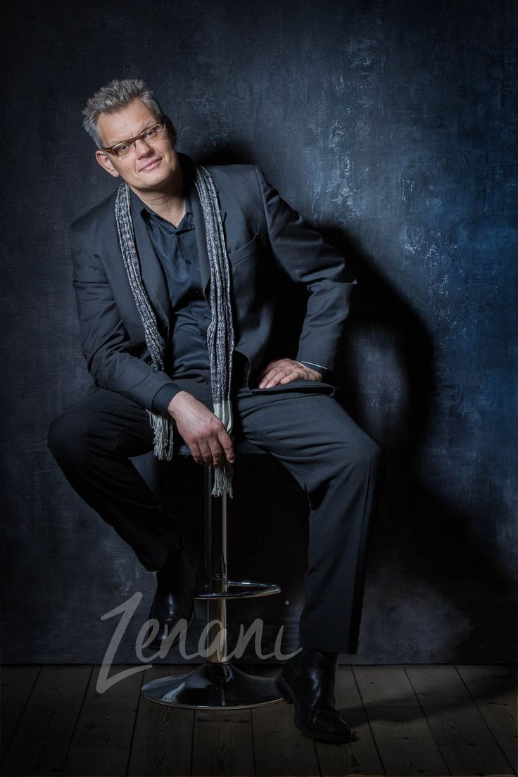 Portrait of man in suit, professional speaker and entertainer