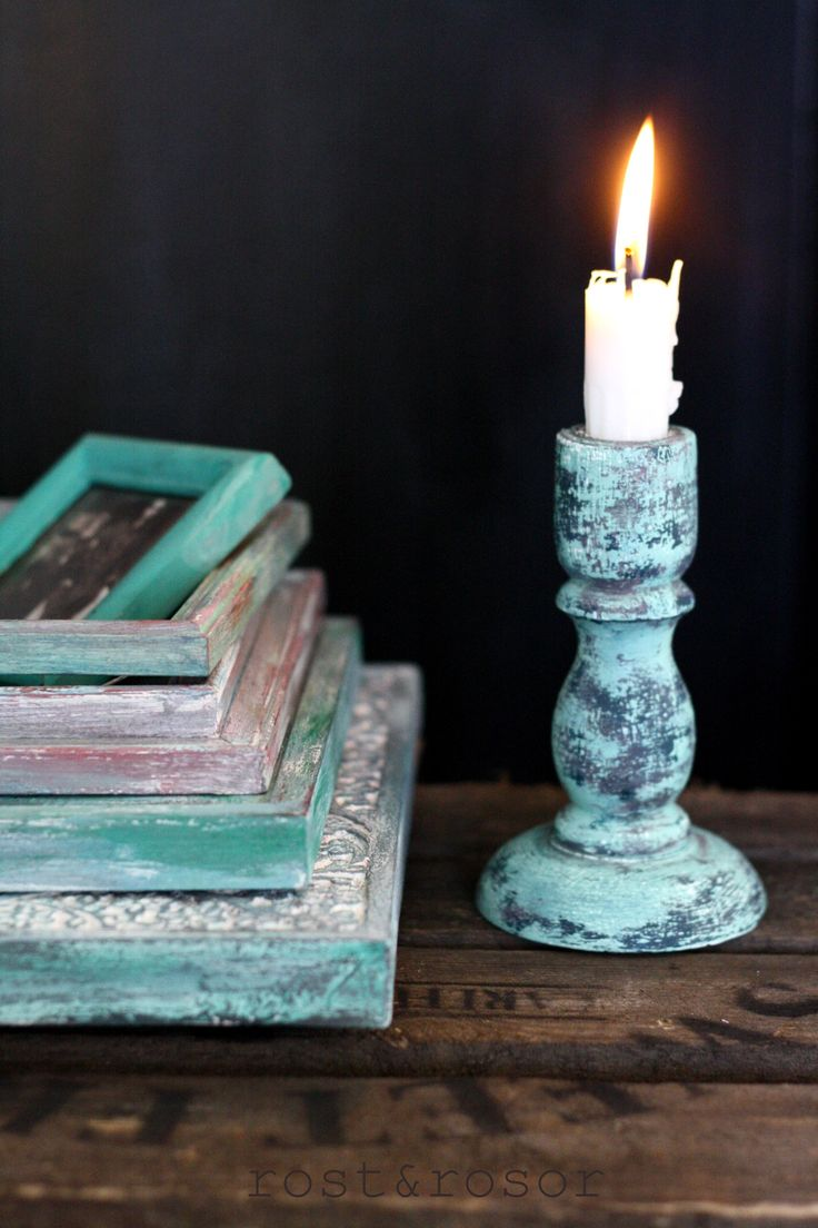 Turquoise frames and candleholder bohemianstyle.
