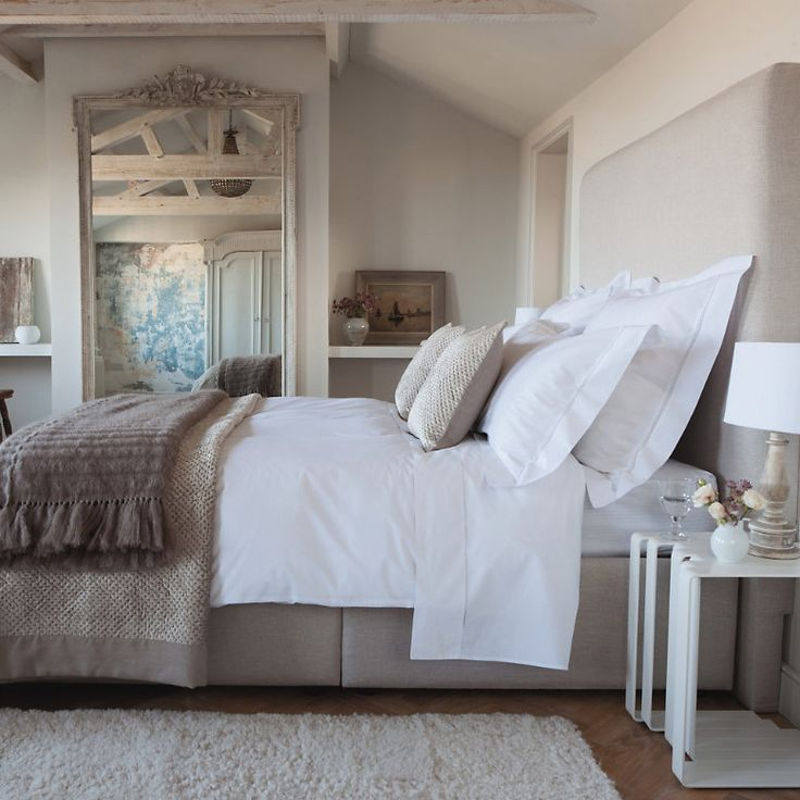 Neutral Bedroom, Beautiful Floor Length Mirror, Light Gray Walls, Gray  Upholstered Headboard, White Bedding And Gray Throw At The Foot Of The Bed.