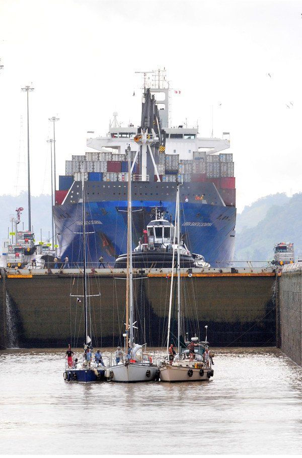 Between 35-40 vessels, ranging from sailboats to gigantic container ships, transit the Panama Canal daily
