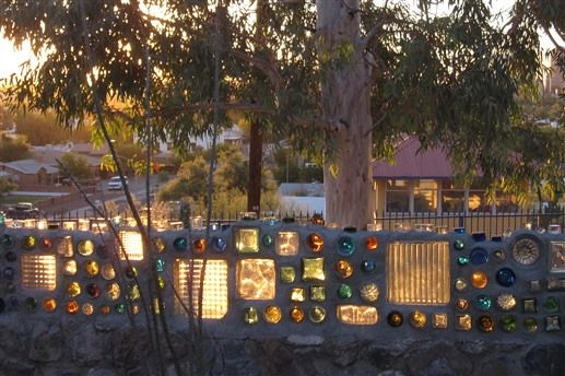 Outdoor wall made of old glass bottles