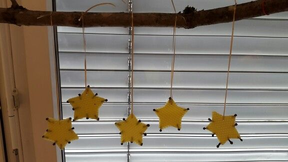 Beeswax stars decorated with cloves