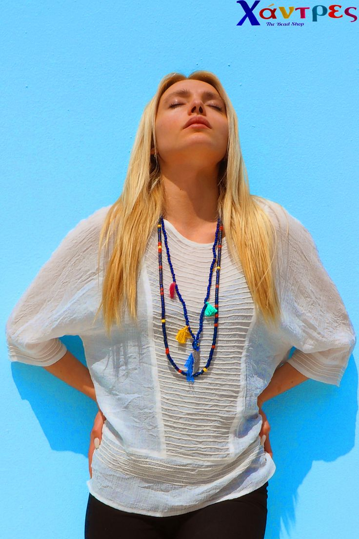 Wear your white linen tunik with your boho style necklaces , these ones made from greek ceramic handmade beads, small tassels and a wing.
