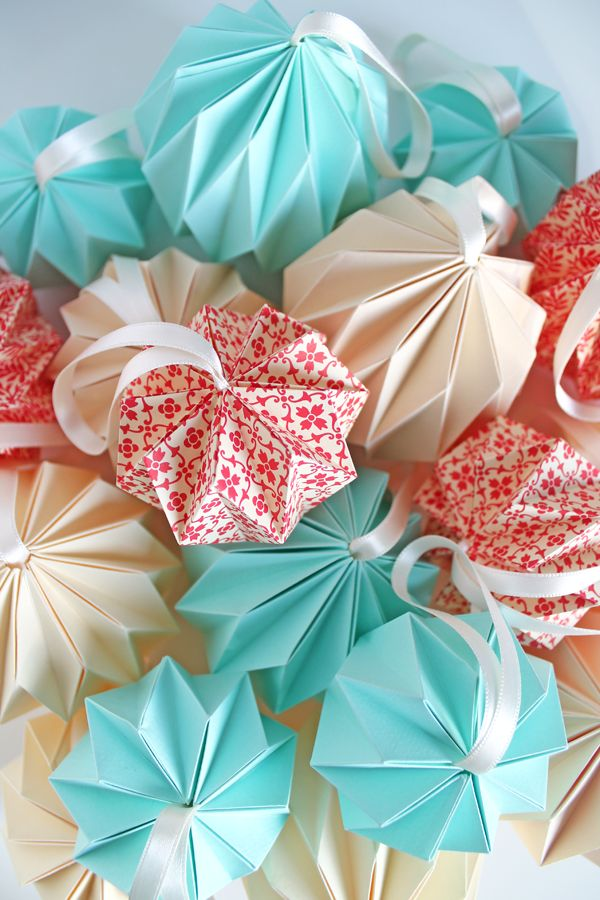 Paper ornaments - gift toppers that can be reused as tree decorations.