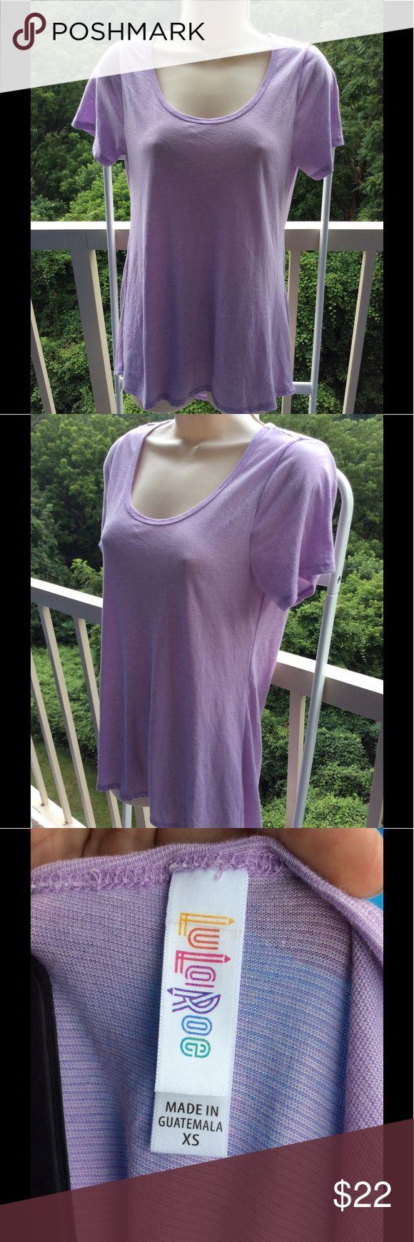 LuLaRoe XS Purple Striped Super Soft Shirt Super soft Lularoe subtly striped purple short sleeve shirt in XS. LuLaRoe Tops Tees - Short Sleeve