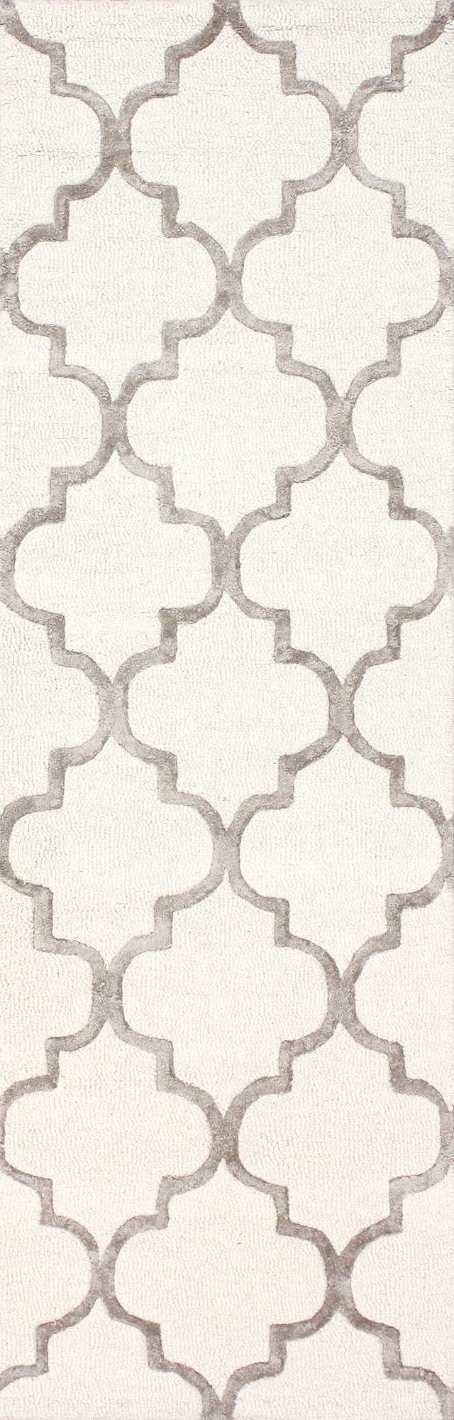 Scalloped lines combine to form an elegant trellis design in the Rugs USA Satara Edison Rug. The soft, neutral tones of this rug enhance many home decors, while the repeating quatrefoils patterned across the rug gives it a sense of contemporary sophistication. The understated elegance of the close-set trellis pattern gives it an air of luxury which causes the rug to be eye-catching but not overwhelming. Made with a blend of wool and viscose, it offers soft and luxurious comfort underfoot…