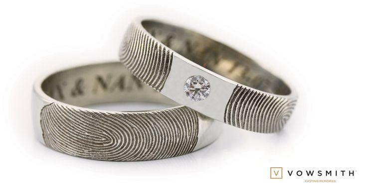 Mirrored fingerprint, nice setup for the 0.10 carat diamond. This customized wedding band set is so popular!