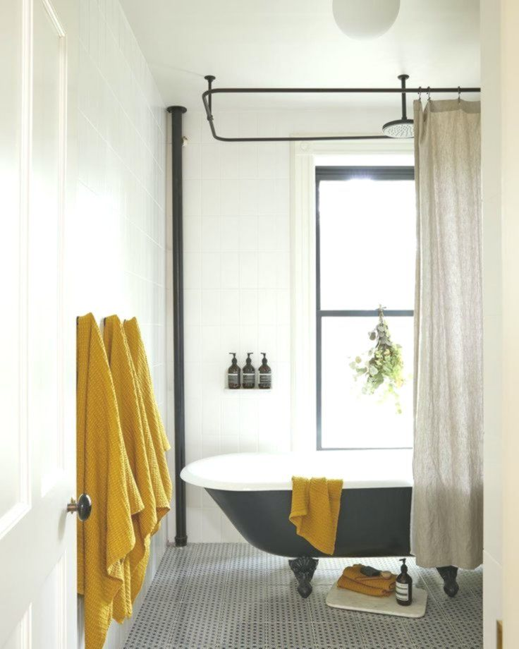 A White Vintage Style Bathroom With Black And Yellow Ochre Accents Mustard Yell Accents Ba Yellow Bathroom Decor Yellow Bathrooms Black And White Decor