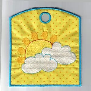"""This free embroidery design is the """"Bless Our Home Wind Sock"""".  Grab it now and make something cute for Spring!"""