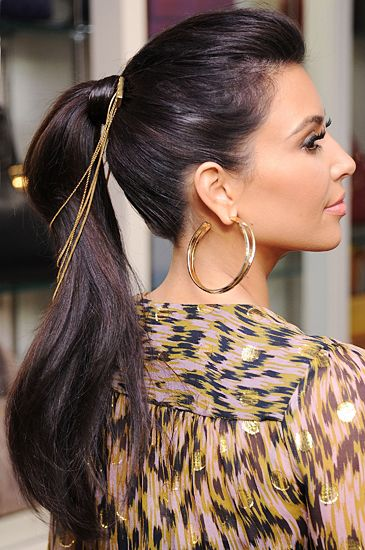 Kim Kardashian adds some fun hair accessories to make a perfect ponytail.