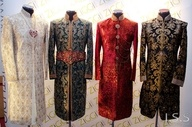 Sherwani is long coat, buttoned up in front with ban collars