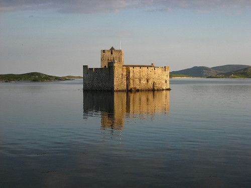 """Kisimul Castle  is a small medieval castle located in the centre of Castlebay on Barra, an island of the Outer Hebrides, Scotland. Kisimul Castle gets its name from the Gaelic words cìs (tax) and mul (mound) meaning """"The place where taxes are paid"""".  The earliest documentary record of Kisimul Castle dates from the mid 16th century. Kisimul sits on a rocky islet in the bay just off the coast of Barra, and as it is completely surrounded by the sea; it can only be reached by boat."""