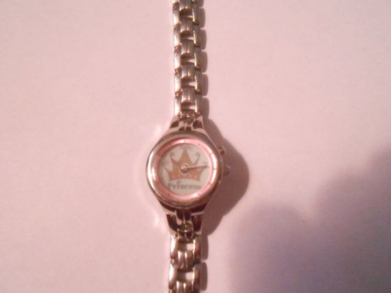 nice ladies big tic fossil watch, lights up princess with a crown around the watch, runs excellent, solid stainless steel.