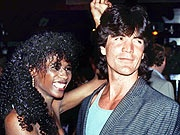 Simon Cowell into black girls from way back. He dated his artist sinitta