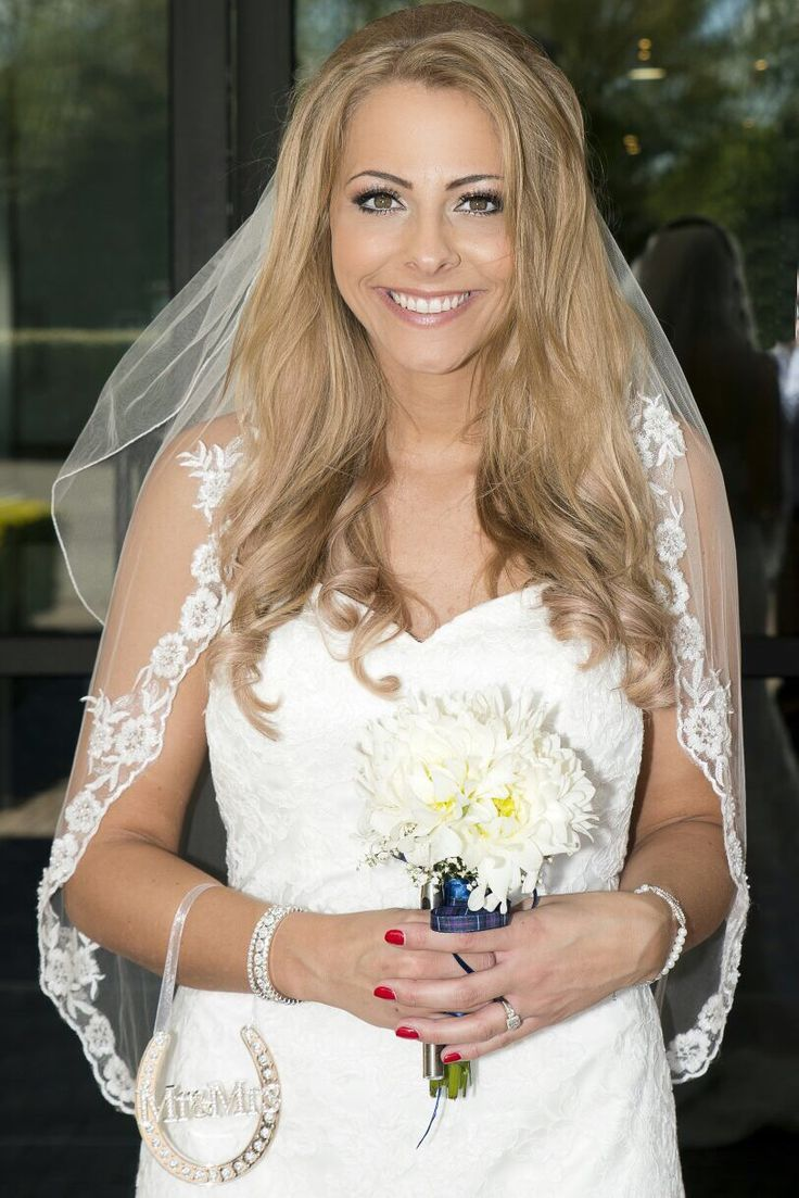My beautiful bride with lots of body and curls to her hair for the big day. Make up by Gemma - www.bristolbridalhairandmakeup.com