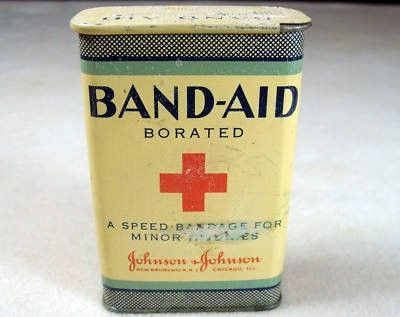 $63 VINTAGE 1940 JOHNSON & JOHNSON BRAND BAND-AID WITH 17 BAND AIDS TIN NO PAPER LABEL- GRAPHICS PAINTED ON TIN MADE BY JOHNSON & JOHNSON NEW BRUNSWICK, NY CHICAGO, ILL., USA MEASURES 1 1/8  X 2 1/4  X 3