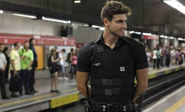 Meet Guilherme Leao: voted hottest subway security guard (Brazil).  He's 22 and now can hardly make his rounds because of all his fans!