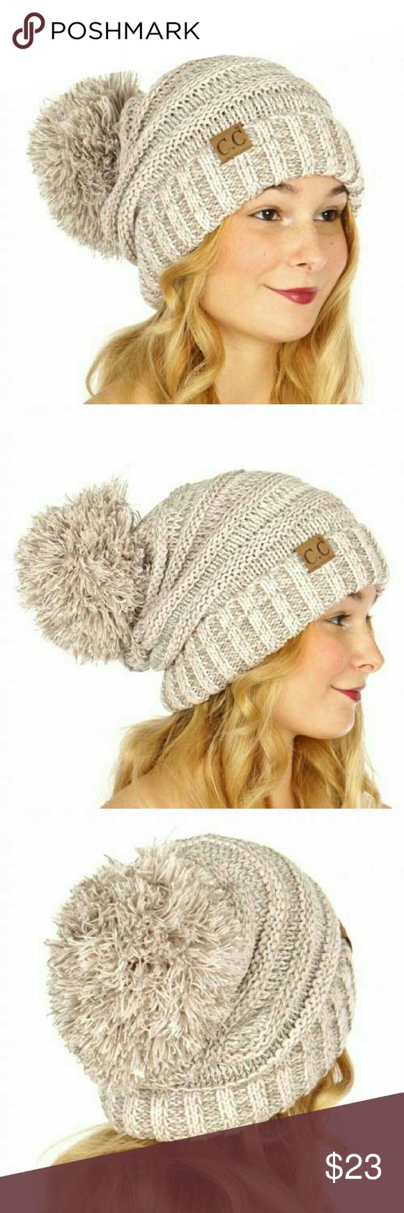 C.C. Pompom Beanie A must have for winter! Oversized CC Brand slouchy pompom beanie in a gorgeous marbled beige and rose color.  100% Acrylic C.C. Accessories Hats
