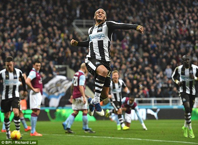 Yoan Gouffran leaps in the air and pumps his first in celebration after putting Newcastle ahead