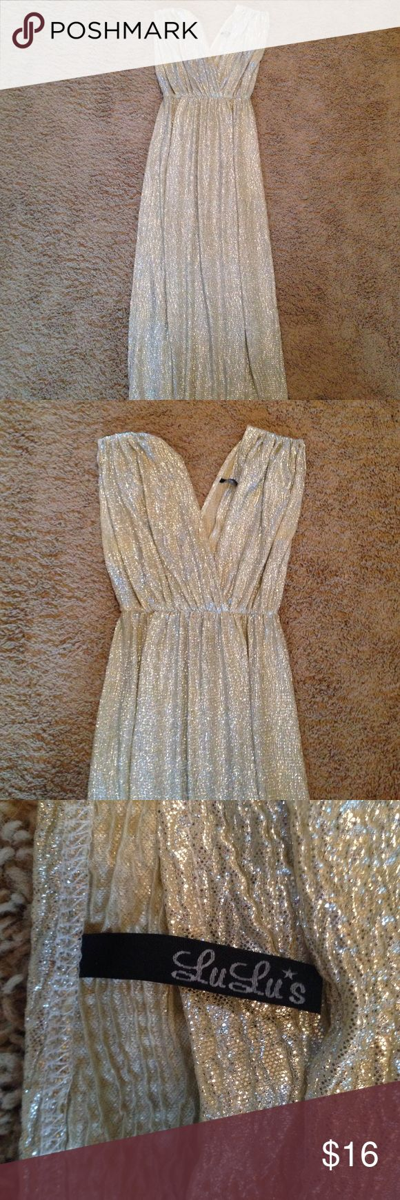 Gold metallic long dress/formal dress This is a Lulus gold sparkley/shimmery metallic gold dress with an elastic waist. Runs large and worn once. There is a little wearing in the color around the arm pit area (last picture) Lulu's Dresses Maxi
