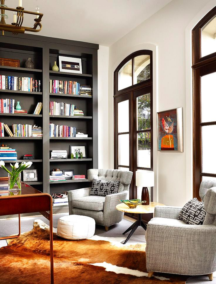 Warm library room with gray armchairs