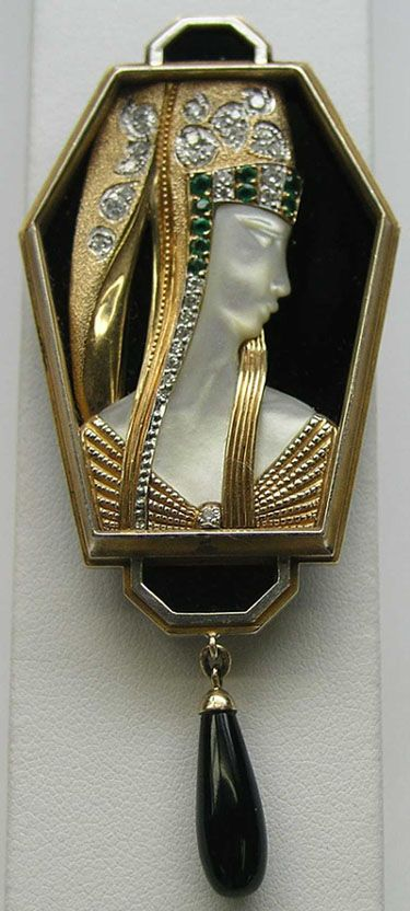 Erte art deco pendant. See also my ERTE board