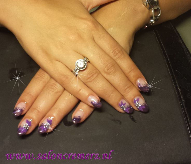 Oblique side French manicure with glitter , leafs and strass flower