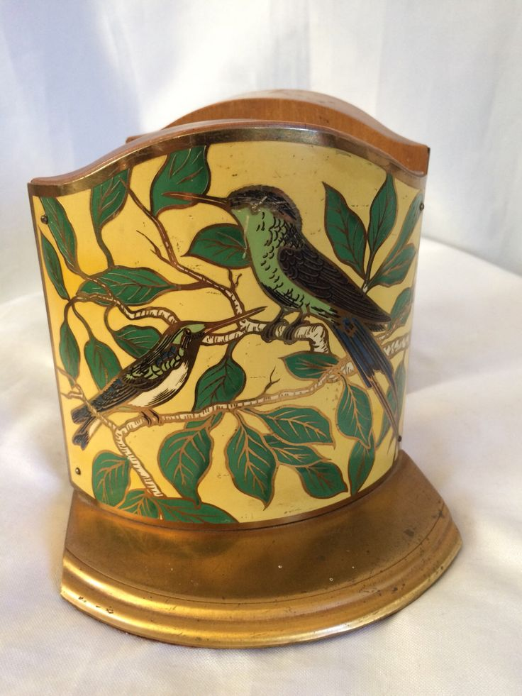 Vintage Tropical Bird Metal & Wood Bookends by VeryOaklandVintage on Etsy https://www.etsy.com/listing/482713194/vintage-tropical-bird-metal-wood
