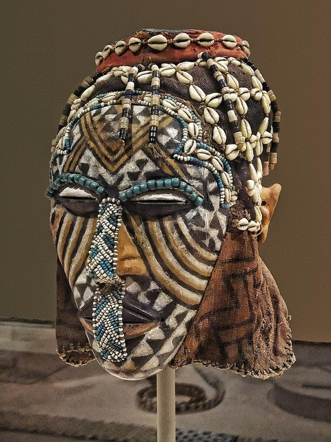 Africa | Mask (Ngady Amwaash) Kuba Kasai region Democratic Republic of Congo Late 19th - mid-20th century CE Wood pigment glass beads cowrie shells fabric and string | Photographed at the Art Institute of Chicago, Chicago, Illinois.