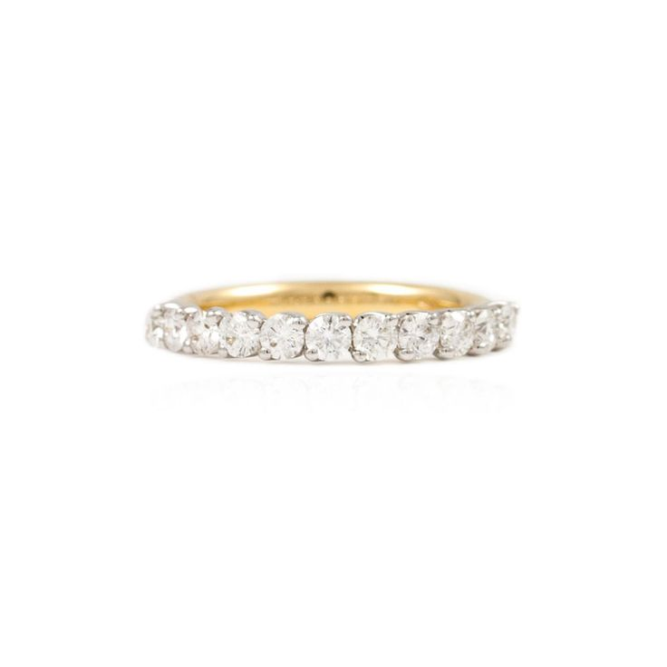 Eleven stone eternity ring. This beautiful eternity ring is made from yellow gold and features eleven round brilliant cut diamonds with each in a twist claw setting.