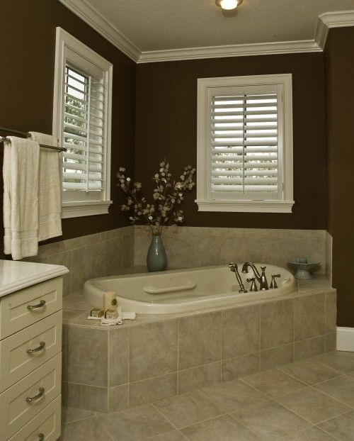 dark bathroom walls & angled tub. just like mine, only prettier...