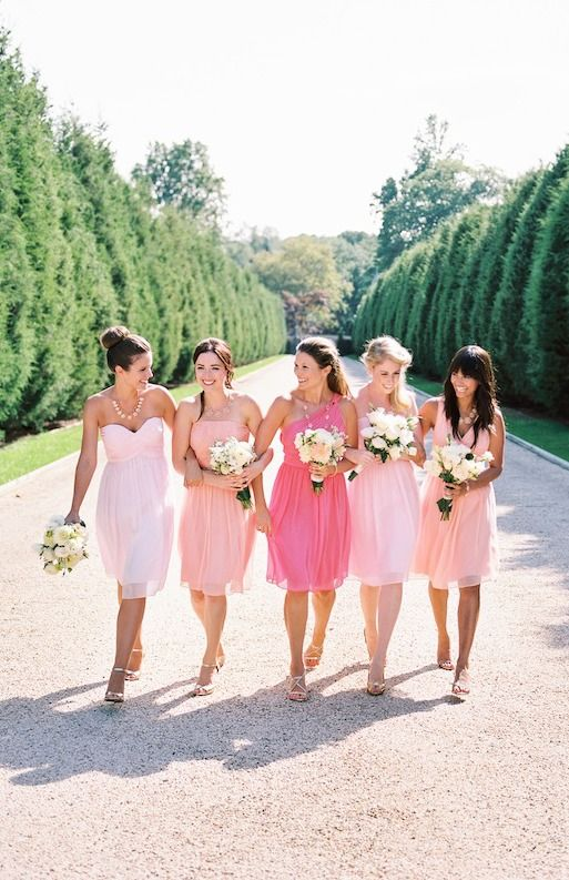 Beautiful and blushing bridesmaids look pretty in pink for a festive Spring wedding.