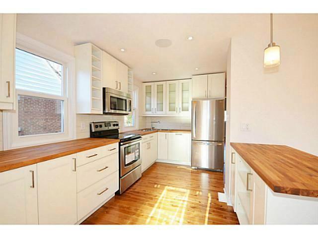 A beautiful bright, WHITE kitchen!