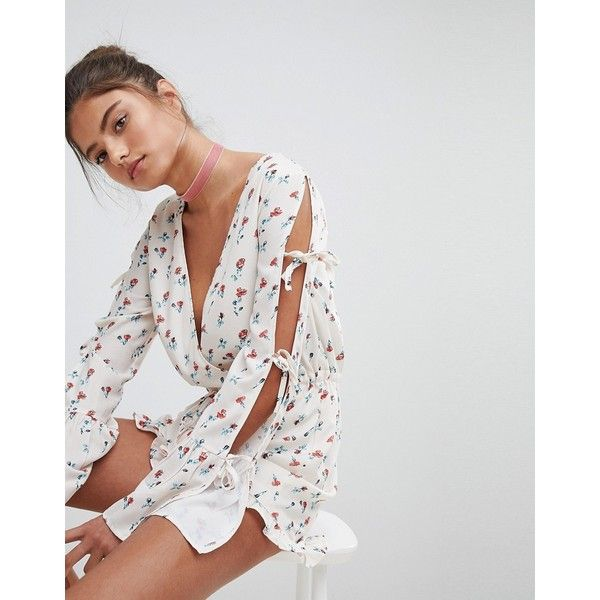 PrettyLittleThing Floral Side Split Romper ($45) ❤ liked on Polyvore featuring jumpsuits, rompers, cream, playsuit romper, going out rompers, floral romper, plunging neckline romper and floral print romper