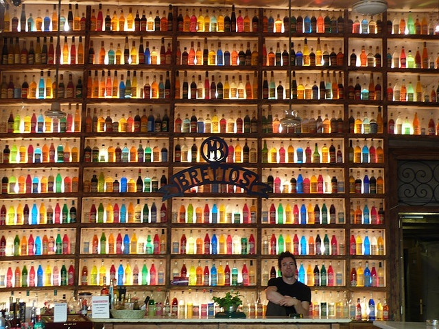 Brettos Bar, Athens, in district near Acropolis with hundreds of colored bottles lit from behind