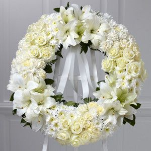 The traditional funeral wreath, beautifully representing the eternal circle of life, is updated for a new era and is beautifully refreshed without losing any of its poignant meaning. This impressive w
