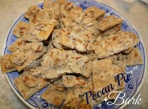 Ingredients: 2 sticks butter 1 cup white sugar 1 & 1/4 cups pecan halves About 2 packages (approx. 12 sheets) honey graham crackers Preheat oven to 325 degrees F. Lay graham crackers tig...