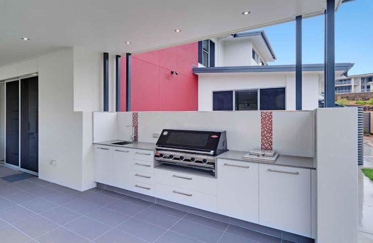 Modern white outdoor patio kitchen with mosaic splashback in Brisbane, Australia home