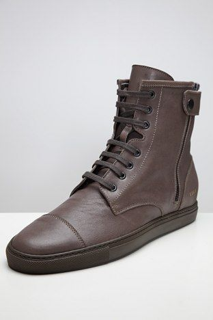 COMMON PROJECTS, LOW PROFILE TRAINING BOOTS: notched ankle and snap tab.
