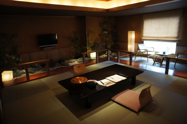 Modern ryokan style room in an Osaka hotel. It has a traditional indoor garden with tatami mats. Amazing and cosy!