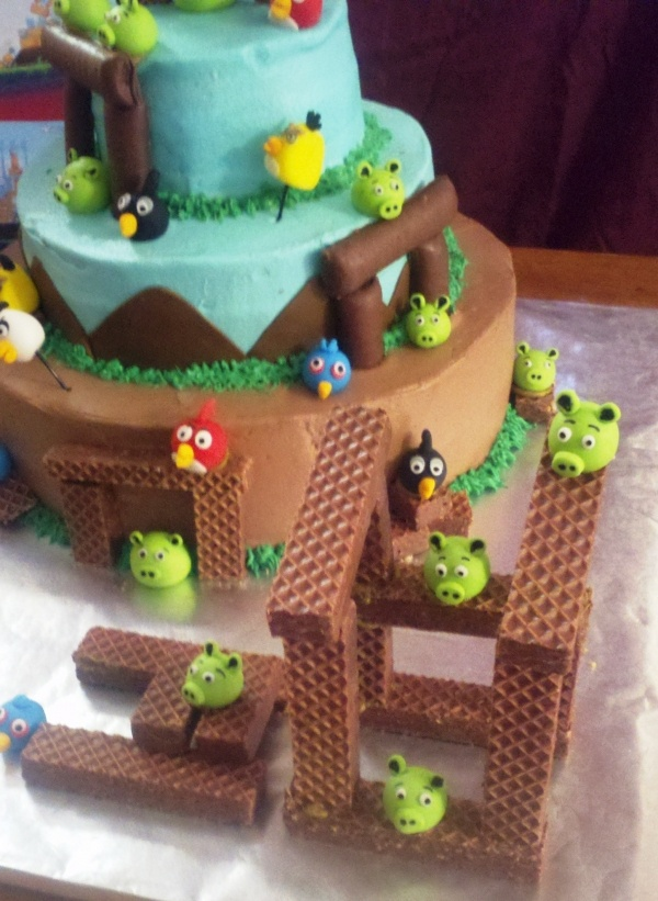Angry Bird birthday cake! I love the chocolate wafer idea . . .