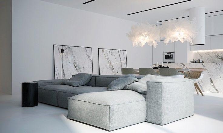 intérieur blanc moderne- salon avec grand canapé d'angle modulable en tissu gris chiné