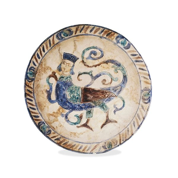 Stone-paste laqabi dish, decorated with a harpy    From Syria  12th century AD. British Museum.