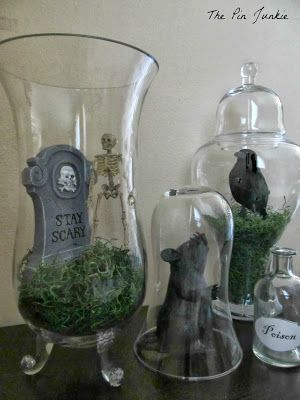 Dollar Store Halloween Decor: Tablescape.  Decorate a spooky table with jars, vases, and items from the dollar store.