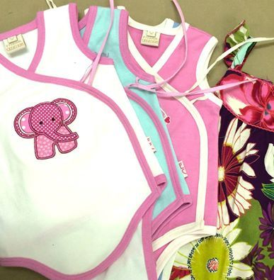 Soft, colourful and cute...little onesies waiting for their buttons and tags!  These fun Fair trade baby rompers are available at http://www.eternalcreation.com/collections/baby-girls-onesies