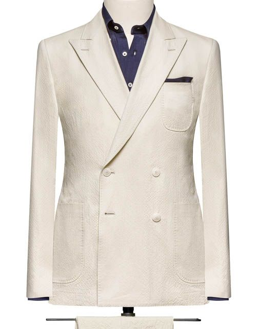 This cloth is a beige seersucker composed of cotton and elastane.Cloth Weight: 240 gramComposition: 97% Cotton and 3% ElastaneShown here made up as a two piece, double breasted suit, with peak lapels and patch pockets.